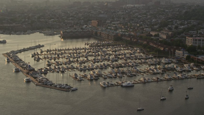 5K stock footage aerial video of boats docked at Anchorage Marina at sunset in Baltimore, Maryland Aerial Stock Footage | AX73_149