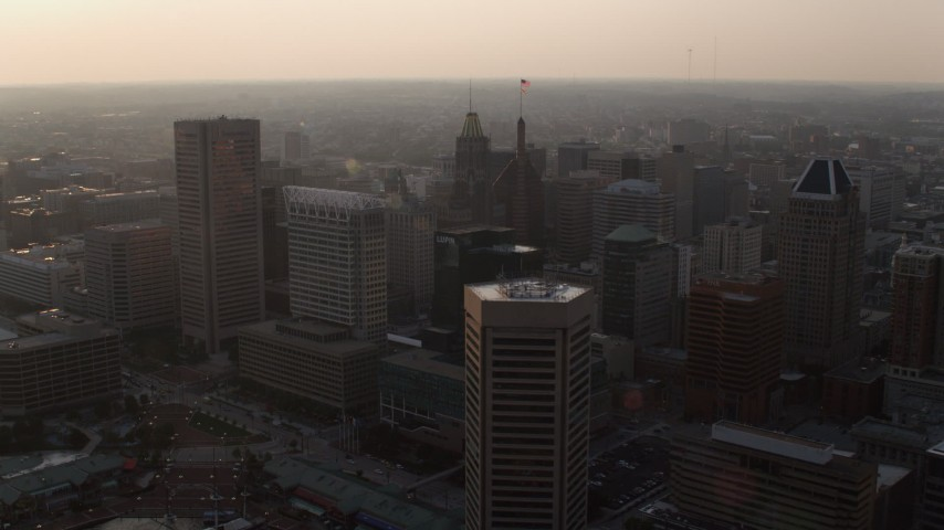 5K aerial video of Downtown Baltimore skyscrapers and office tower at sunset, Maryland Aerial Stock Footage | AX73_153