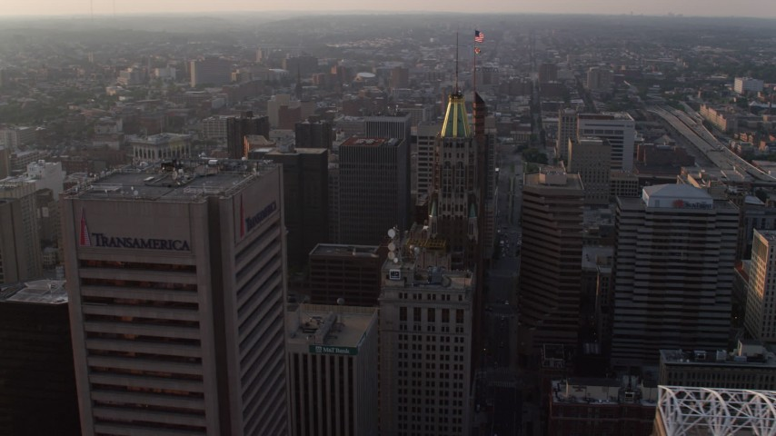 5K stock footage aerial video of Bank of America Building and Transamerica Tower at sunset, Downtown Baltimore, Maryland Aerial Stock Footage | AX73_154