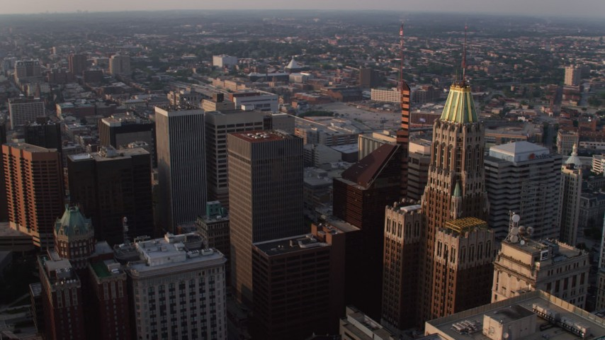 5K aerial video of Schaefer Tower and the Bank of America Building at sunset, Downtown Baltimore, Maryland Aerial Stock Footage | AX73_155
