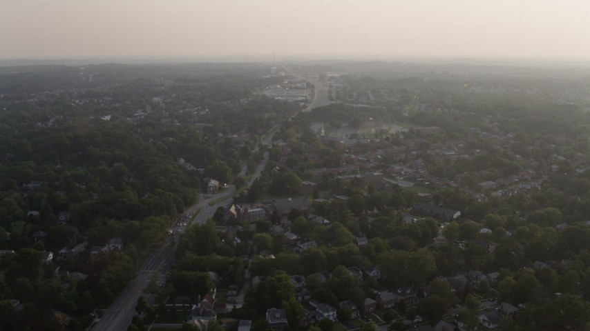 5K stock footage aerial video of row houses and suburbs at sunset, Baltimore, Maryland Aerial Stock Footage | AX73_156