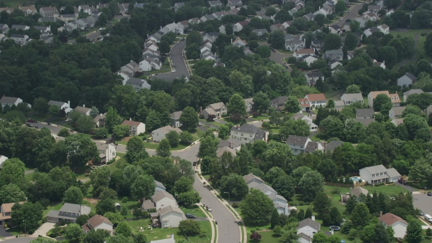 5K stock footage aerial video approaching and tilting to Spacious Homes and Streets in Manassas, Virginia Aerial Stock Footage | AX74_003
