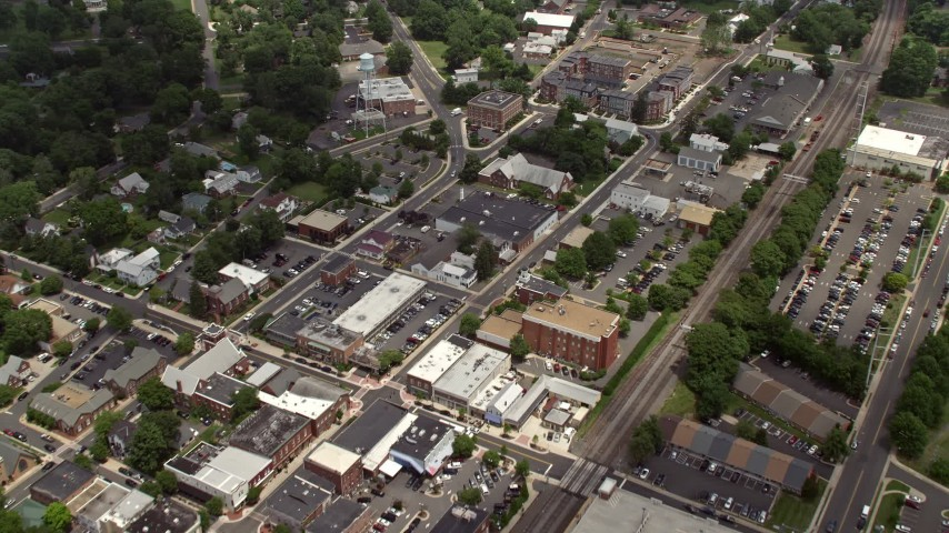 5K stock footage aerial video flying over water tower, shops and streets in Manassas, Virginia Aerial Stock Footage | AX74_004
