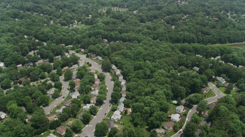 5K aerial video flying over suburban residential neighborhoods in Fairfax, Virginia Aerial Stock Footage | AX74_013