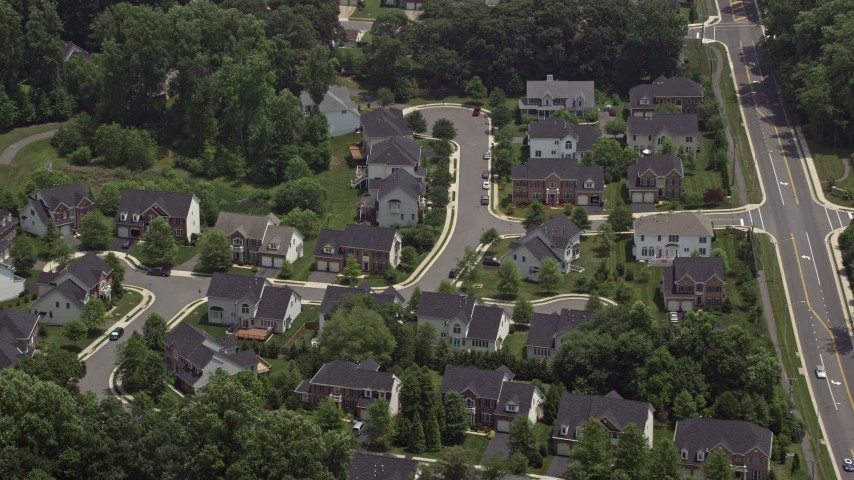 5K aerial video of suburban homes by quiet streets in Fairfax, Virginia Aerial Stock Footage | AX74_014