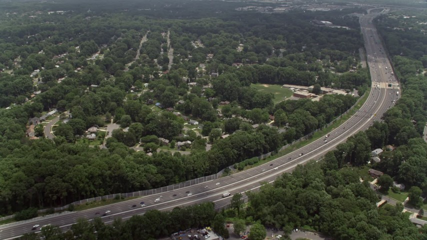 5K stock footage aerial video flying over freeway, approaching an elementary school in Springfield, Virginia Aerial Stock Footage | AX74_019