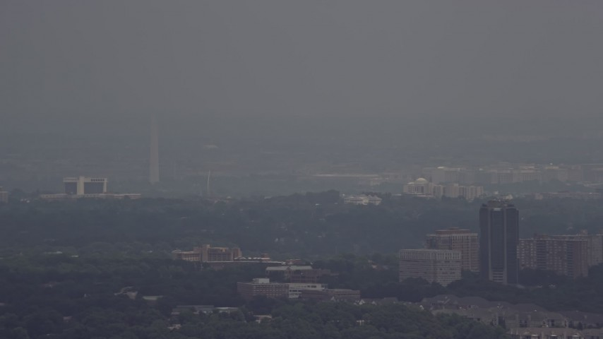 5K stock footage aerial video of the Washington Monument in thick haze in Washington DC Aerial Stock Footage | AX74_020