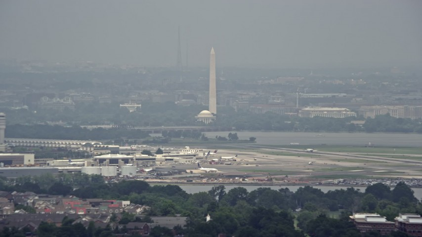 5K aerial video of White House, Washington Monument and Jefferson Memorial seen from Reagan National in Washington DC Aerial Stock Footage | AX74_028