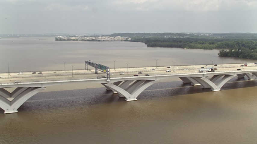 5K stock footage aerial video of Woodrow Wilson Memorial Bridge Spanning the Potomac River  Aerial Stock Footage | AX74_029