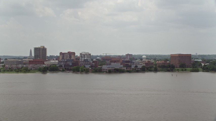 5K stock footage aerial video of office buildings by the Potomac River in Alexandria, Virginia Aerial Stock Footage | AX74_031