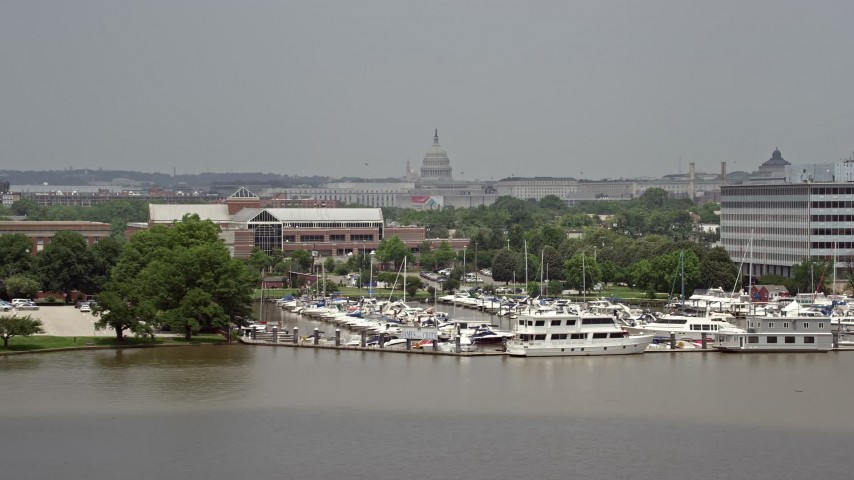 5K stock footage aerial video of the United States Capitol in Washington DC seen from the James Creek Marina Aerial Stock Footage | AX74_035