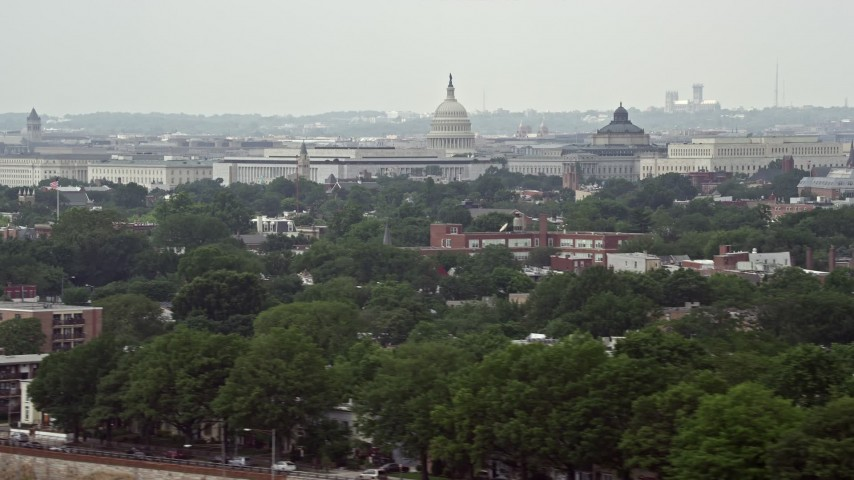 5K aerial video of the domes of United States Capitol and Thomas Jefferson Building in Washington DC Aerial Stock Footage | AX74_042