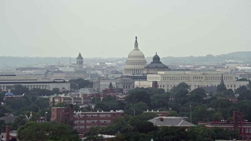 5K stock footage aerial video of the United States Capitol and Thomas Jefferson Building in Washington DC Aerial Stock Footage | AX74_043
