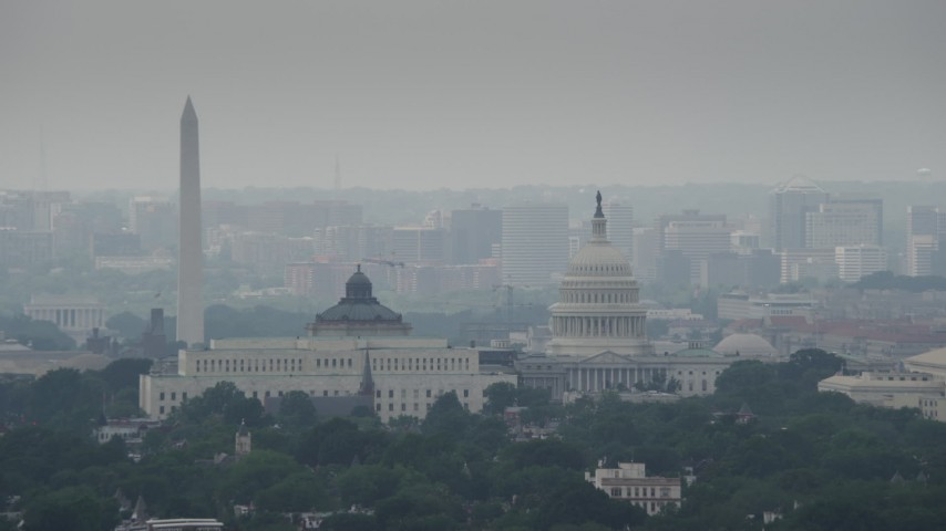 5K stock footage aerial video of Washington Monument, Library of Congress buildings, and United States Capitol Dome in Washington DC Aerial Stock Footage | AX74_045