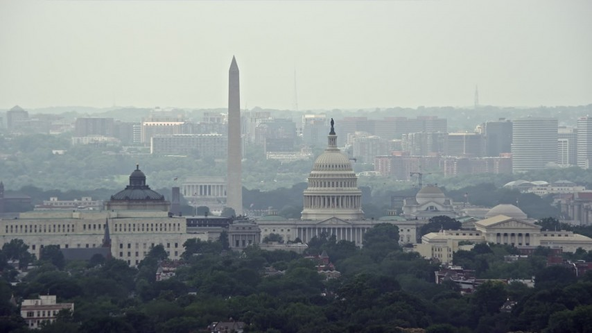 5K stock footage aerial video of Washington Monument, Library of Congress buildings, and United States Capitol Dome in Washington DC Aerial Stock Footage | AX74_045E