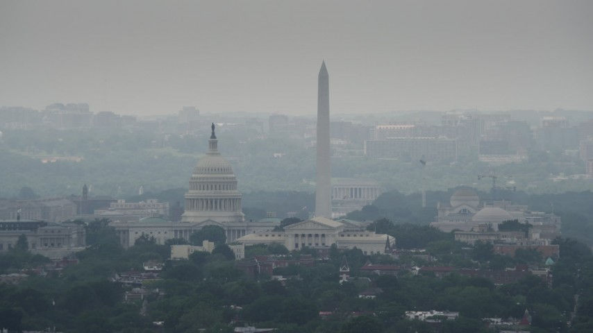 5K stock footage aerial video of United States Capitol Dome, Supreme Court, and National Mall Monuments in Washington DC Aerial Stock Footage | AX74_047