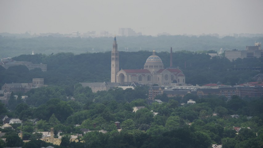 5K stock footage aerial video of Basilica of the National Shrine of the Immaculate Conception in Washington DC Aerial Stock Footage | AX74_050