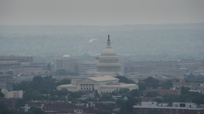 5K aerial video of United States Capitol behind the Supreme Court Building in Washington DC Aerial Stock Footage | AX74_053
