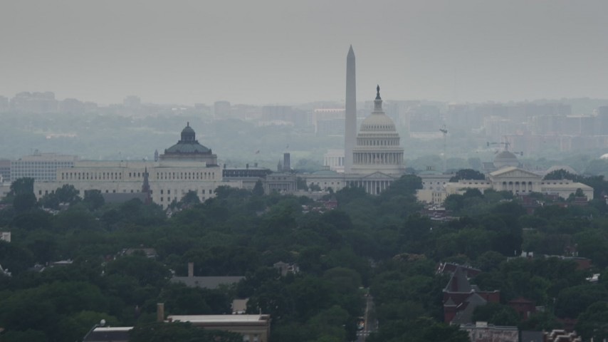 5K aerial video of the United States Capitol, Thomas Jefferson and John Adams Buildings, and the Washington Monument in Washington DC Aerial Stock Footage | AX74_056