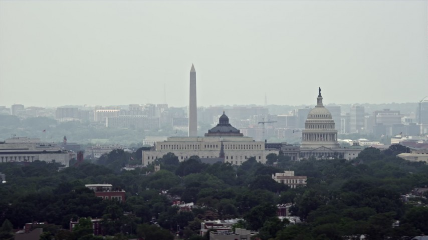 5K stock footage aerial video of the United States Capitol, Thomas Jefferson and John Adams Buildings, and the Washington Monument in Washington DC Aerial Stock Footage | AX74_056E