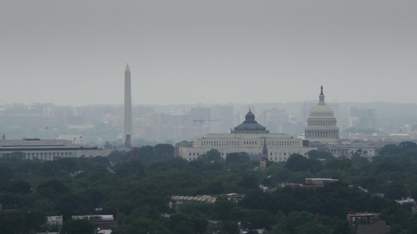 5K stock footage aerial video of the Washington Monument, United States Capitol, and Library of Congress buildings in Washington DC Aerial Stock Footage | AX74_057