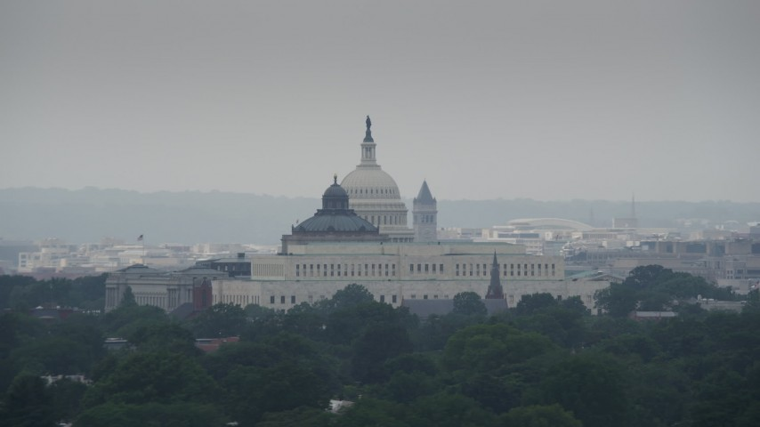 5K aerial video of the United States Capitol and Library of Congress Buildings in Washington DC Aerial Stock Footage | AX74_058