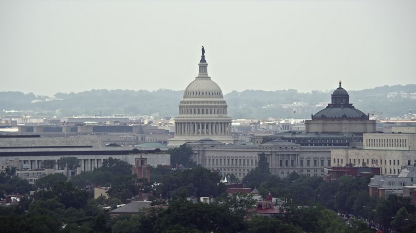 5K stock footage aerial video of the United States Capitol and Library of Congress Buildings in Washington DC Aerial Stock Footage   AX74_058E