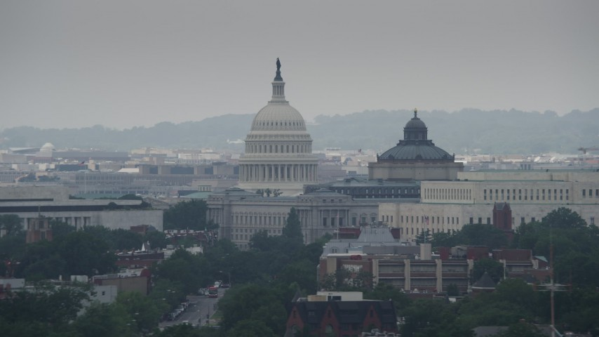 5K stock footage aerial video of the United States Capitol dome between Library of Congress buildings in Washington DC Aerial Stock Footage | AX74_059