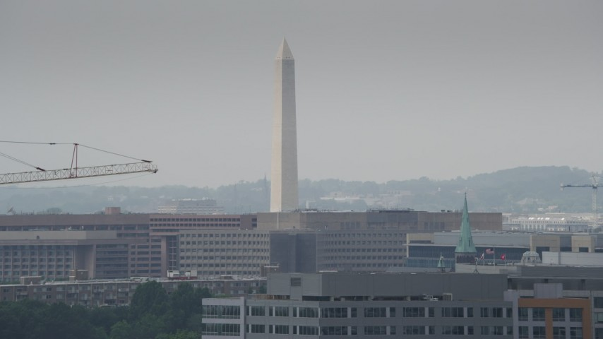 5K stock footage aerial video of the Washington Monument behind a tall construction crane in Washington DC Aerial Stock Footage | AX74_061