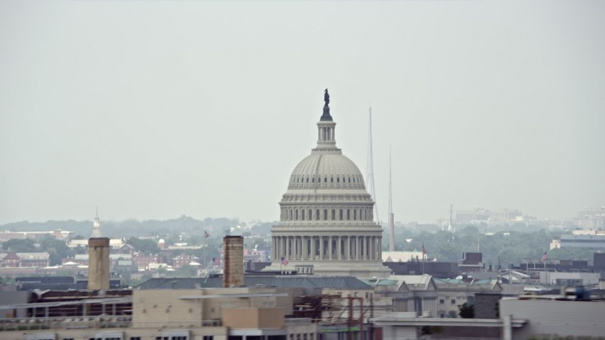 5K stock footage aerial video of the United States Capitol Dome and a construction crane in Washington DC Aerial Stock Footage | AX74_062