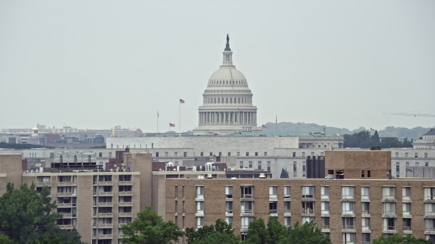 5K stock footage aerial video of the United States Capitol Dome seen from apartment buildings in Washington DC Aerial Stock Footage   AX74_064E