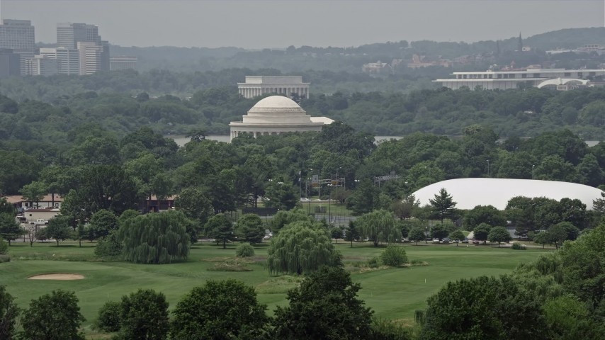 5K stock footage aerial video of the Jefferson Memorial and trees in West Potomac Park in Washington DC Aerial Stock Footage | AX74_066