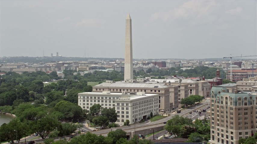 5K aerial video of Washington Monument near government office buildings on 14th Street in Washington DC Aerial Stock Footage | AX74_069