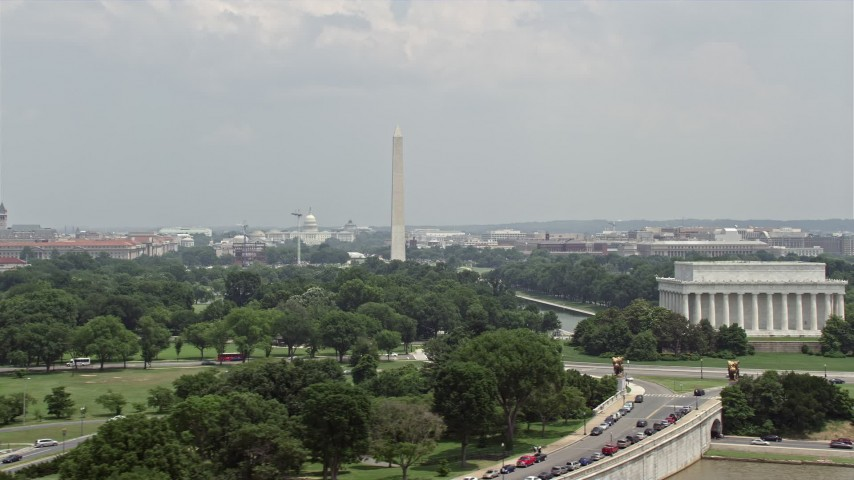 5K stock footage aerial video of a view across the National Mall at the United States Capitol and the Washington Monument in Washington DC Aerial Stock Footage | AX74_076