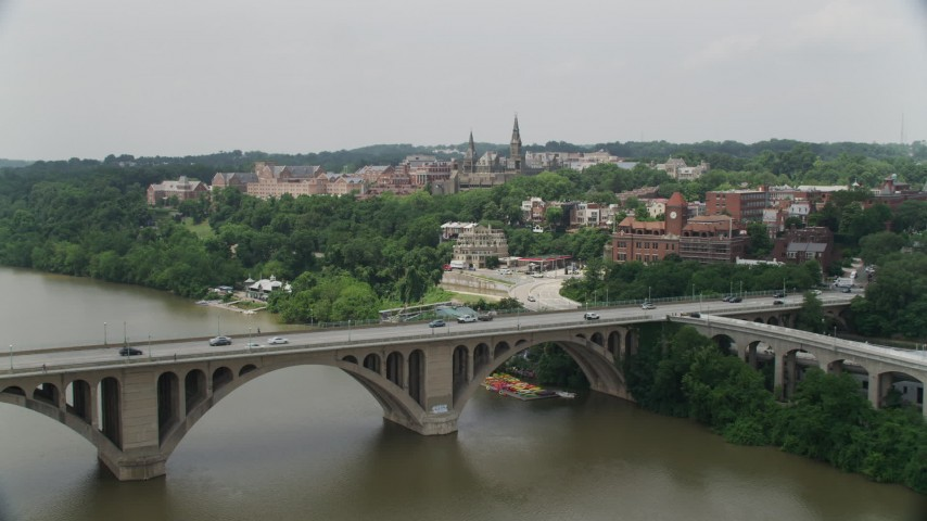 5K aerial video flying over Francis Scott Key Bridge to approach Georgetown University in Washington DC Aerial Stock Footage | AX74_080