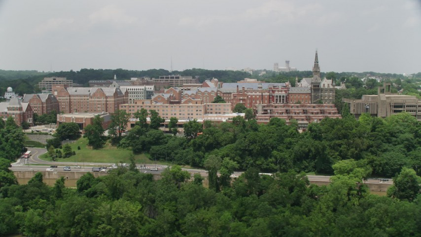 5K stock footage aerial video of Georgetown University seen from Potomac River in Washington DC Aerial Stock Footage | AX74_081