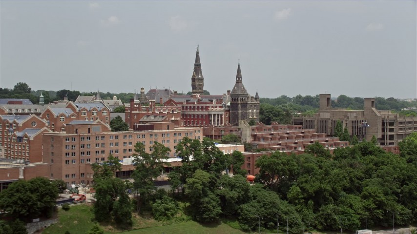 5K stock footage aerial video flying by Georgetown University in Washington DC Aerial Stock Footage AX74_083