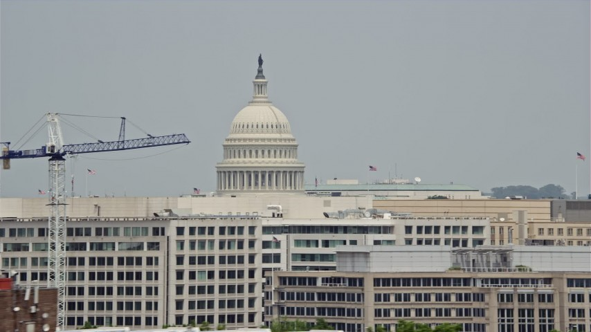 5K stock footage aerial video of United States Capitol Dome seen above office buildings in Washington DC Aerial Stock Footage | AX74_089E