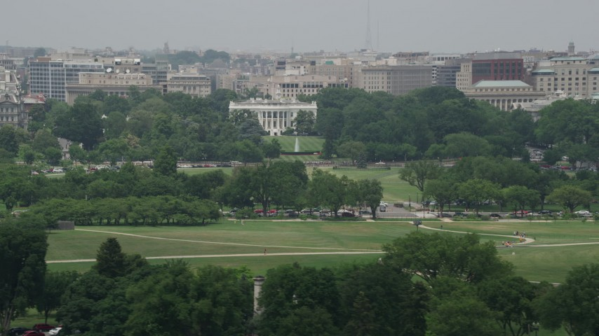 5K stock footage aerial video of The White House, South Lawn, and the base of Washington Monument in Washington DC Aerial Stock Footage | AX74_095