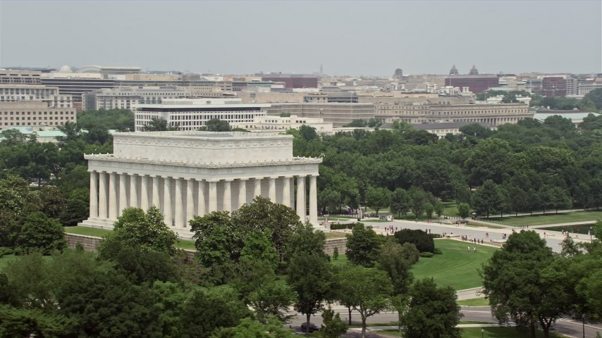 5K aerial video orbiting the Lincoln Memorial and green trees in Washington DC Aerial Stock Footage | AX74_097