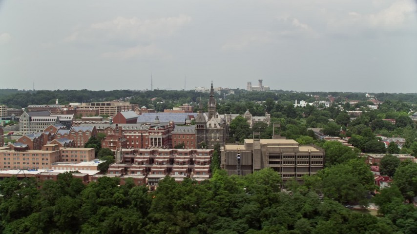 5K stock footage aerial video flying by the campus of Georgetown University in Washington DC Aerial Stock Footage | AX74_101
