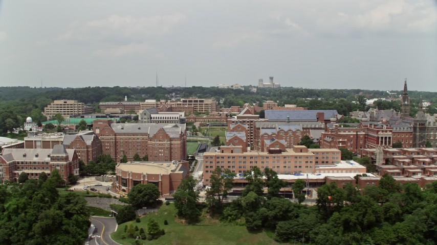 5K aerial video passing the campus of Georgetown University in Washington DC Aerial Stock Footage | AX74_102