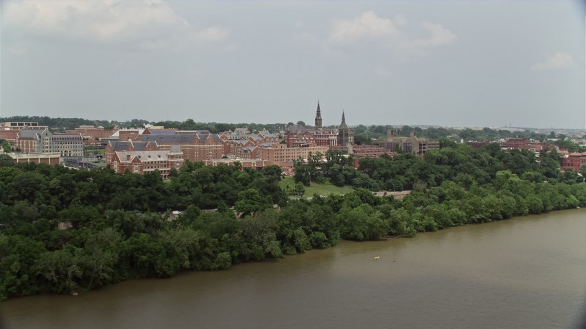 5K stock footage aerial video of Georgetown University seen from the Potomac River in Washington DC Aerial Stock Footage | AX74_104