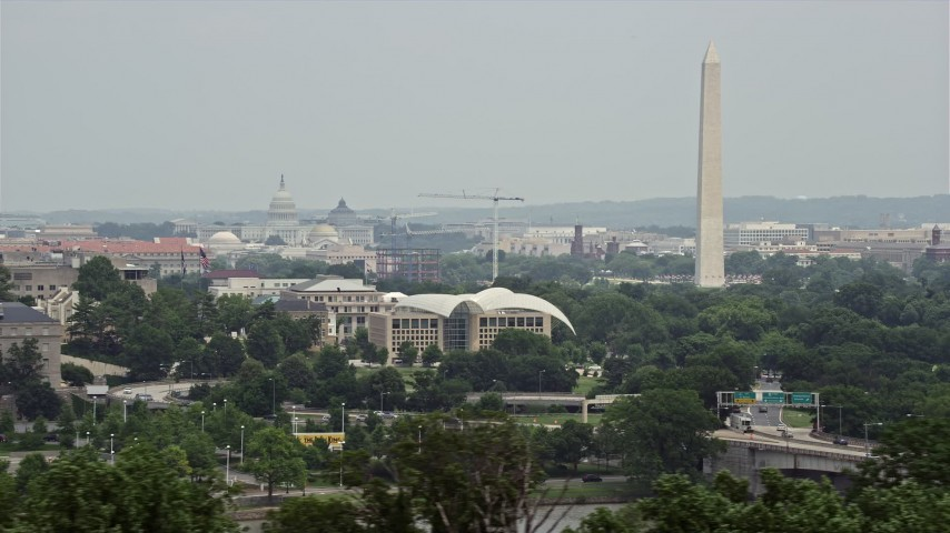5K stock footage aerial video of the United States Capitol, United States Institute of Peace, and the Washington Monument in Washington DC Aerial Stock Footage | AX74_107