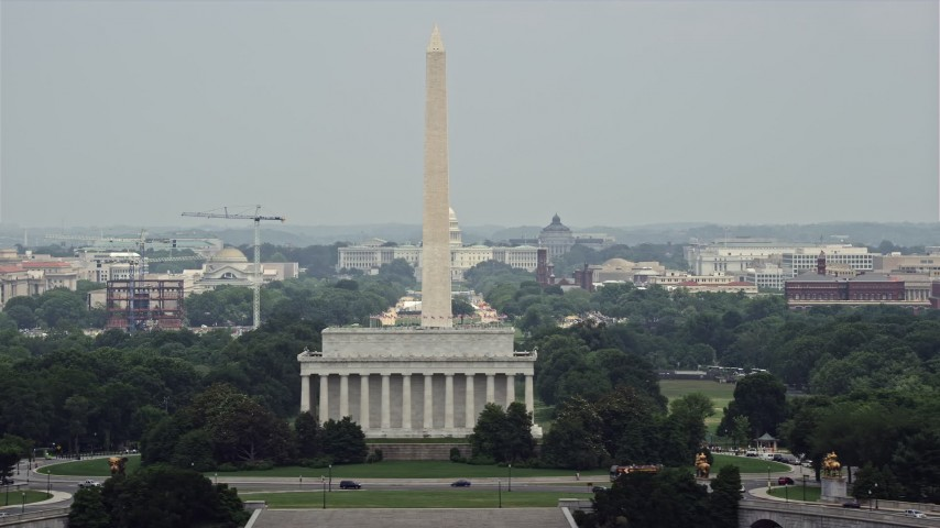 5K stock footage aerial video of the United States Capitol and Washington Monument seen from Lincoln Memorial in Washington DC Aerial Stock Footage | AX74_109