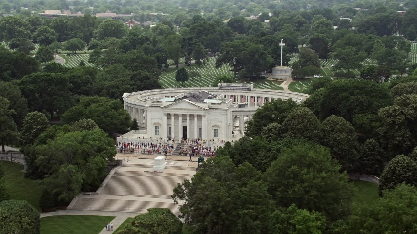 5K stock footage aerial video flying by the Tomb of the Unknown Soldier Monument with tourists at Arlington National Cemetery, Washington DC Aerial Stock Footage | AX74_113