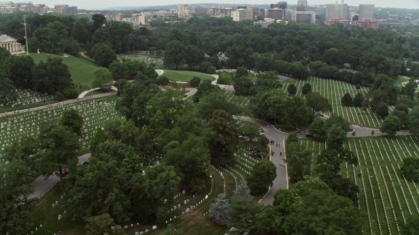 5K stock footage aerial video flying by rows of grave stones at Arlington National Cemetery, Washington DC Aerial Stock Footage | AX74_114