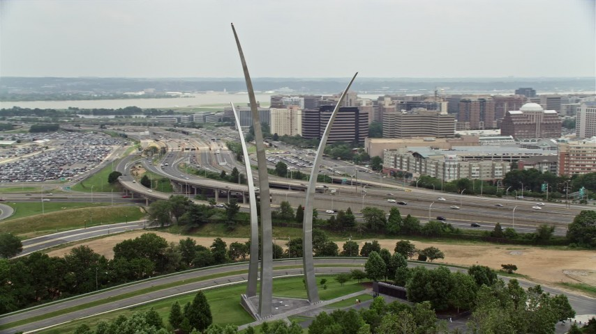 5K aerial video orbiting United States Air Force Memorial to reveal The Pentagon in Washington, DC Aerial Stock Footage | AX74_118