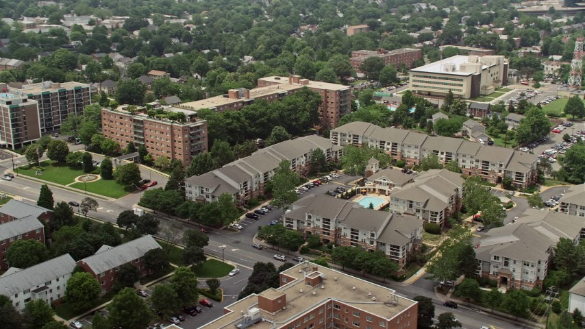 5K stock footage aerial video flying by apartment complexes in Arlington, Virginia Aerial Stock Footage | AX74_119