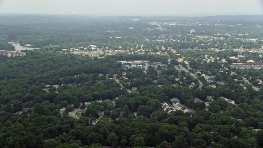 5K stock footage aerial video of suburban homes and trees in Alexandria, Virginia Aerial Stock Footage | AX74_124